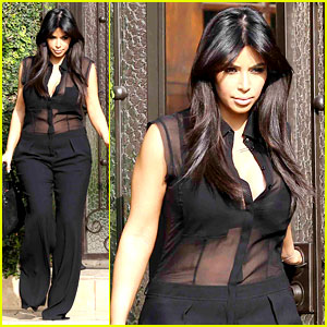 kim-kardashian-pregnant-in-sheet-top-en-route-to-airport